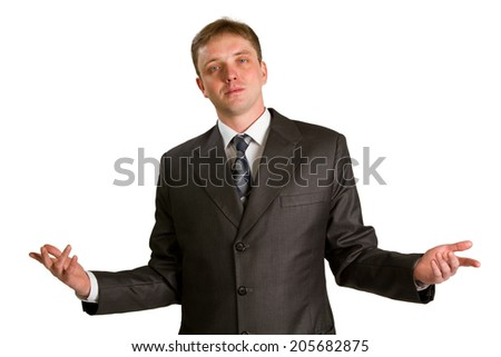 Young businessman posing in a suit isolated in white