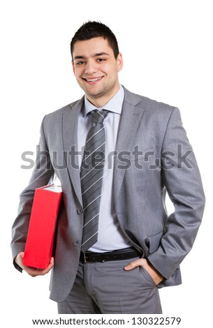 Young businessman posing with folder in his hands.