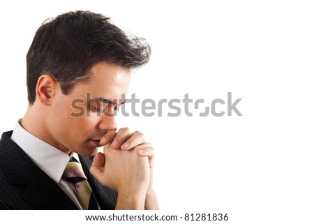 Young businessman praying. Isolated against white background. - stock photo