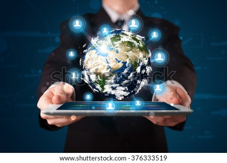 Young businessman presenting 3d earth globe in tablet