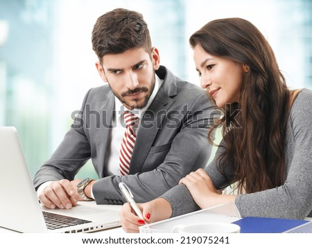 Young businessman presenting his idea to his colleagues. Teamwork at office.  - stock photo