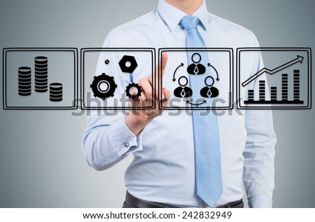young businessman pressing business icons, close up - stock photo