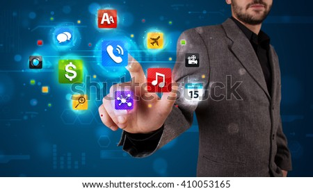 Young businessman pressing various collection of buttons - stock photo