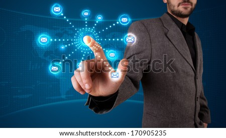 Young businessman pressing virtual messaging type of icons - stock photo