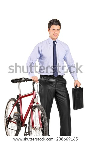 Young businessman pushing a bike and holding a briefcase isolated on white background - stock photo