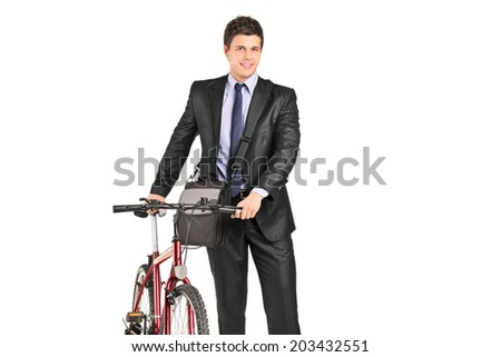 Young businessman pushing a bike isolated on white background - stock photo