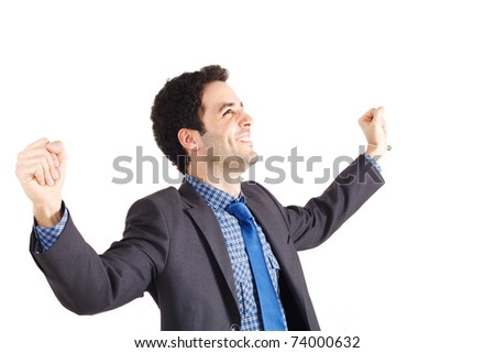 Young businessman raising his hands in sign of victory. Isolated against white background.