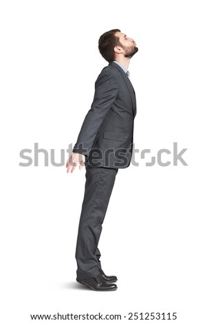 young businessman raising up and kissing empty copyspace. isolated on white background