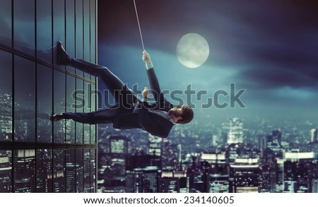 young businessman reaching the top - stock photo