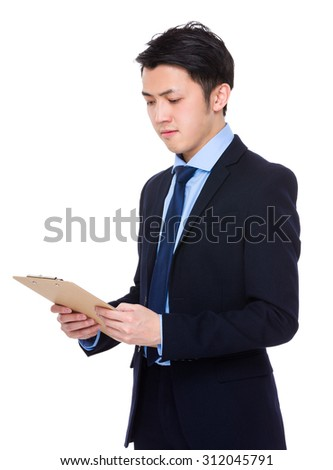 Young businessman read on the clipboard