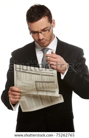 Young businessman reading newspaper isolated on white background - stock photo