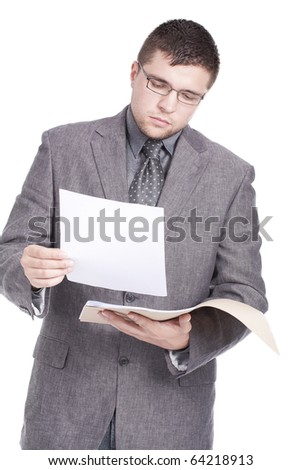 young businessman reading papers from work