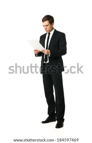 young businessman reading papers from work isolated on white background