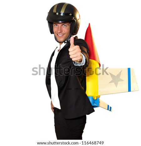 young businessman ready to climb with rocket on his back - isolated on white with clipping path - stock photo