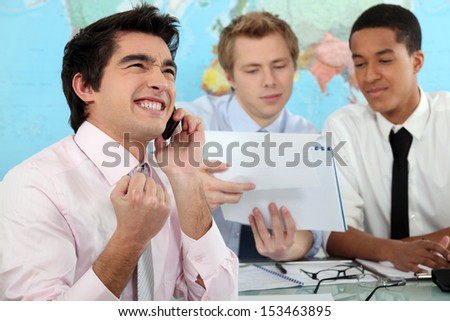 Young businessman rejoicing - stock photo