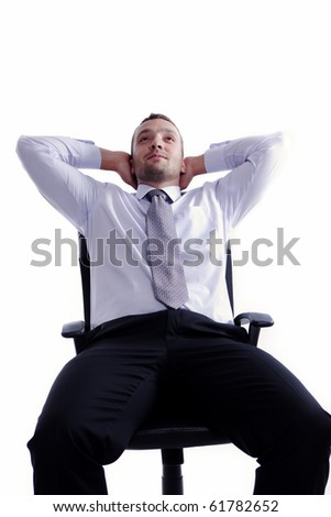 Young businessman relaxing in his business leather chair, isolated on white - stock photo