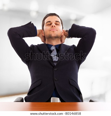 Young businessman relaxing in his office - stock photo