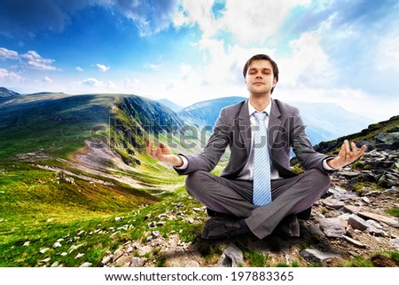 Young businessman relaxing in the mountains, away from the city life and business meetings - stock photo