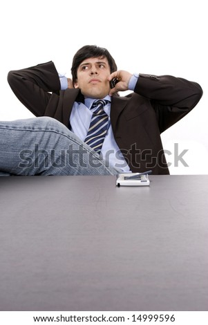 Young Businessman relaxing on the phone, isolated in white background