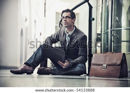 Young businessman resting - stock photo