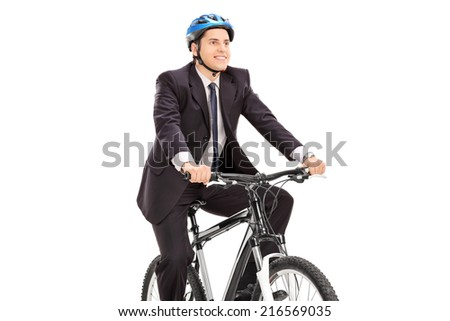 Young businessman riding a bicycle isolated on white background - stock photo