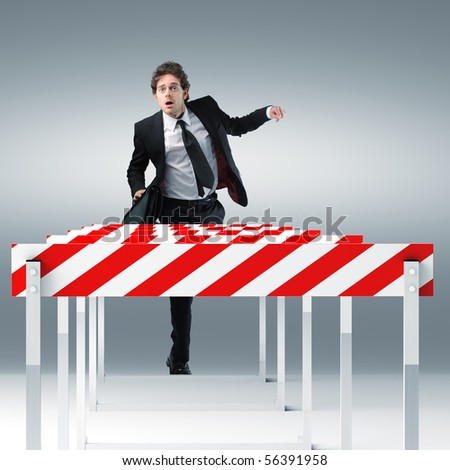 young businessman run towards 3d sport obstacle - stock photo