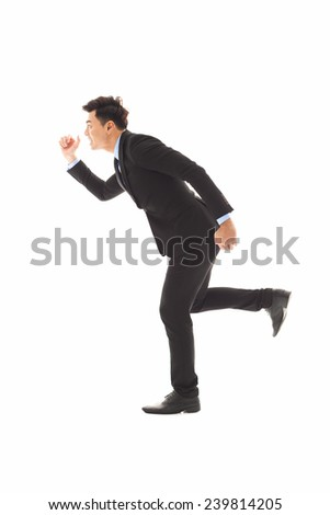 young businessman running forward