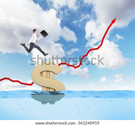 Young businessman running up a red painted graph on a sea background, blue sky, huge gold dollar sign afloat under him. Concept of wealth. - stock photo