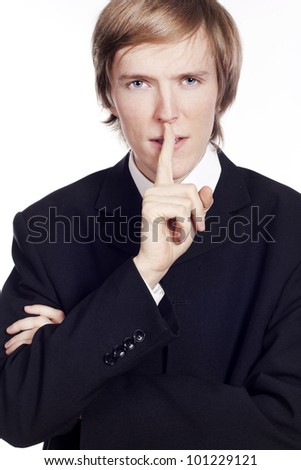 Young businessman saying Shh - stock photo