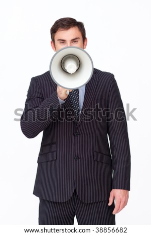 Young businessman shouting through a megaphone against white - stock photo