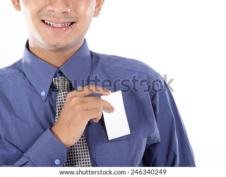 Young businessman show blank business card - stock photo