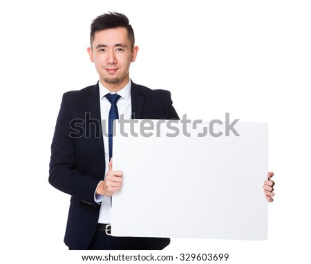 Young businessman show with the white banner