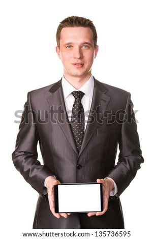 Young businessman showing a tablet pc comuter with blank screen for your sample text isolated on white