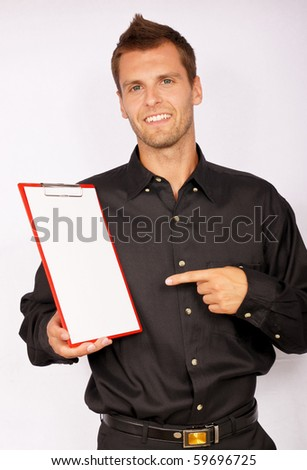 Young businessman showing blank paper. There you can write a text - stock photo