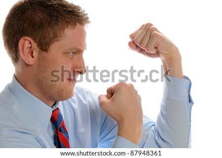 Young Businessman showing fists and ready to fight isolated on a white background - stock photo