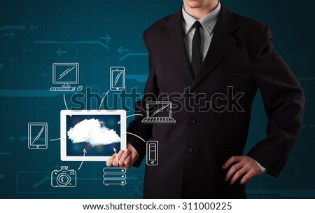 Young businessman showing hand drawn cloud computing - stock photo
