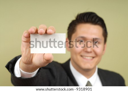 Young businessman showing off his blank business card that is ready for text - stock photo