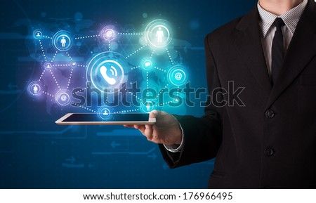 Young businessman showing social networking technology with colorful lights