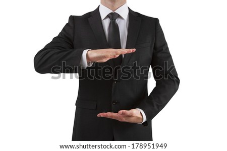 young businessman showing something on a white background