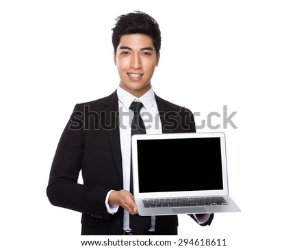 Young Businessman showing the blank screen of laptop computer