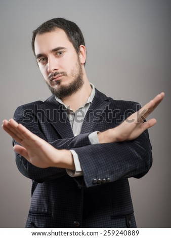 young businessman showing time out sign with hands against - stock photo