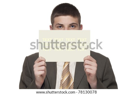Young businessman shows an empty card - stock photo