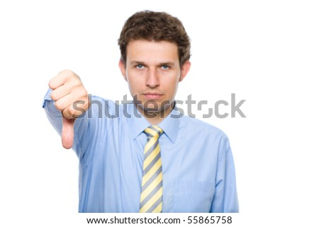 young businessman shows thumb down gesture, unhappy, sad face, studio shoot isolated on white - stock photo