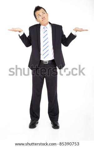 Young businessman shrugging and isolated on white - stock photo