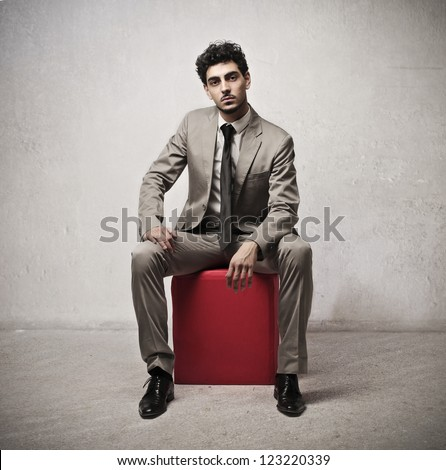 Young businessman sitting - stock photo