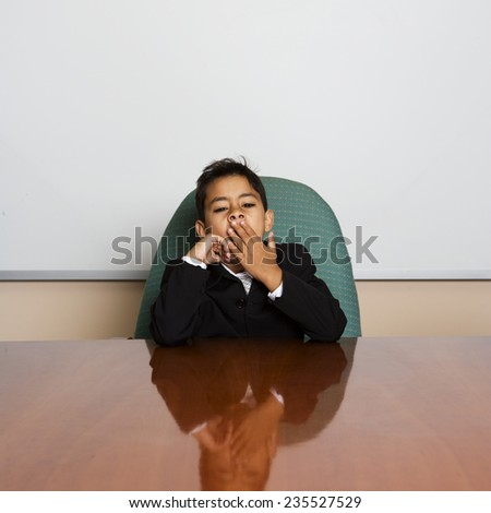 Young Businessman Sitting at Conference Table - stock photo