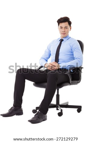 Young businessman sitting in a chair isolated - stock photo