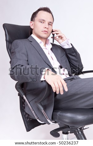 Young businessman sitting on chair.
