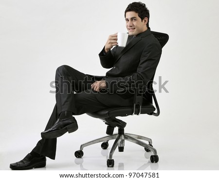 Young businessman sitting on the chair - stock photo