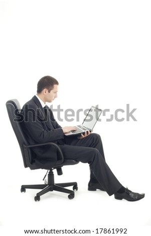 Young businessman sitting with laptop